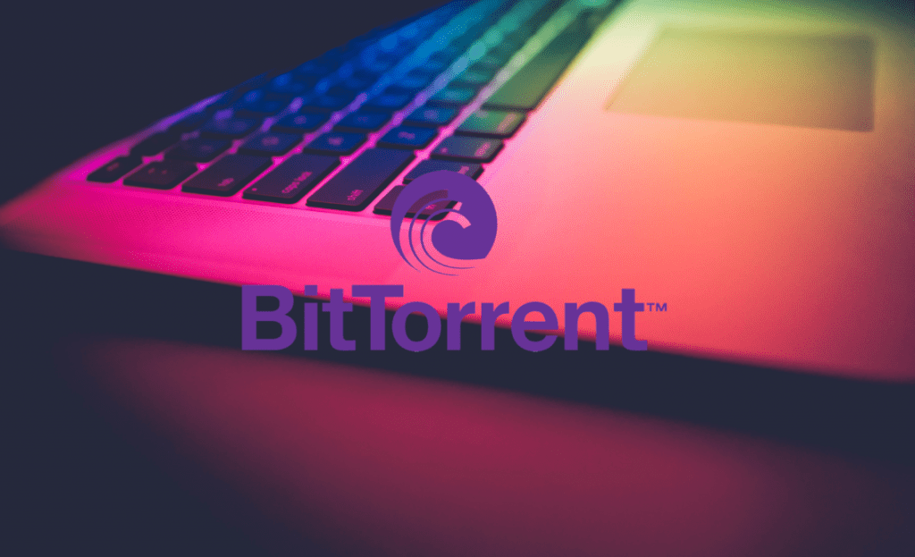 "bitTorrent computer logo background 1140x694 1 1024x623 - Former CSO At BitTorrent Slams Tron As ""Unsuitable"" For BitTorrent Token (BTT) And Compares Justin Sun To Donald Trump"